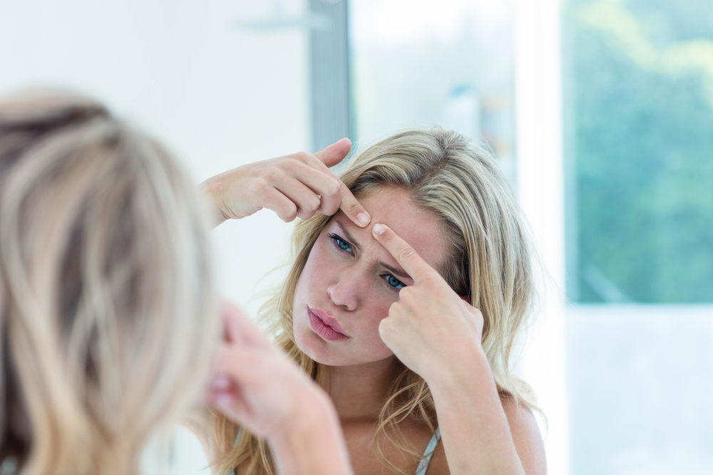 How Popping Pimples Can Worsen Acne Breakouts